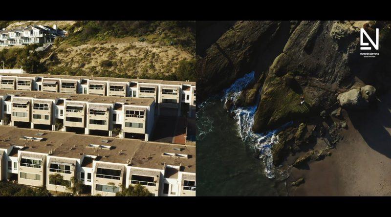 stillbild på delad skärm, hus till vänster och klippor och vatten till höger